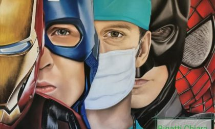 Coronavirus: medici e infermieri trasformati in supereroi da un'opera